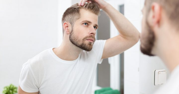 Man wondering how to shave head with a razor